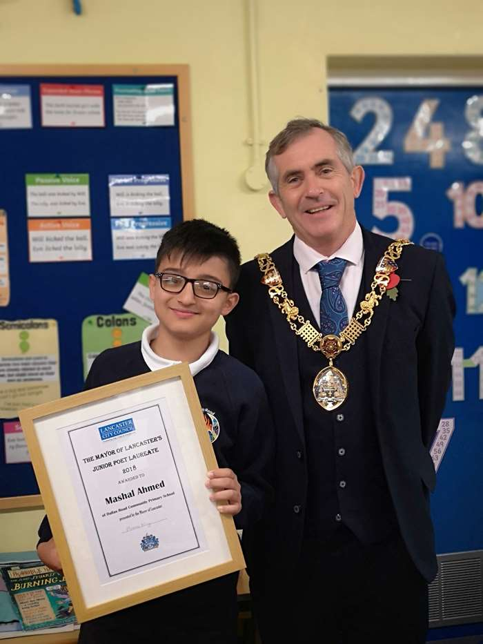 Winner of the poetry competition, Mashal Ahmed, with the Mayor of Lancaster, Coun Andrew Kay.
